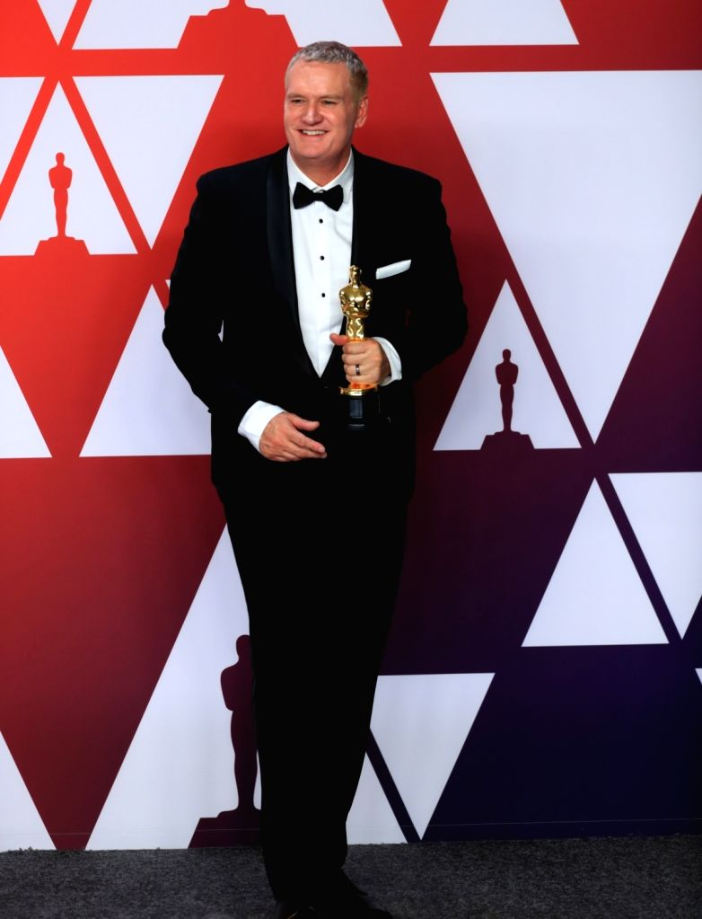 "LOS ANGELES, Feb. 25, 2019 - John Ottman poses for photos after winning the Best Film Editing award for ""Bohemian Rhapsody"" in the press room during the 91st Academy Awards ceremony, or the ..."
