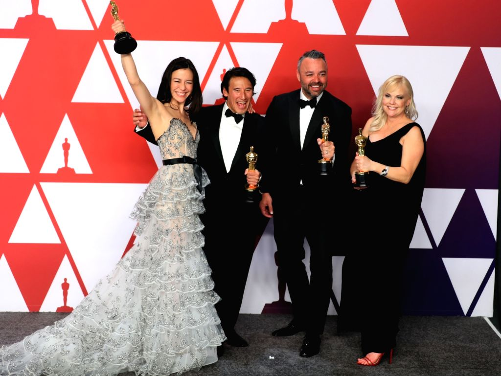 """LOS ANGELES, Feb. 25, 2019 - (L-R) Elizabeth Chai Vasarhelyi, Jimmy Chin, Evan Hayes and Shannon Dill, pose with the Best Documentary Feature award for """"Free Solo"""" in the press room during ..."""