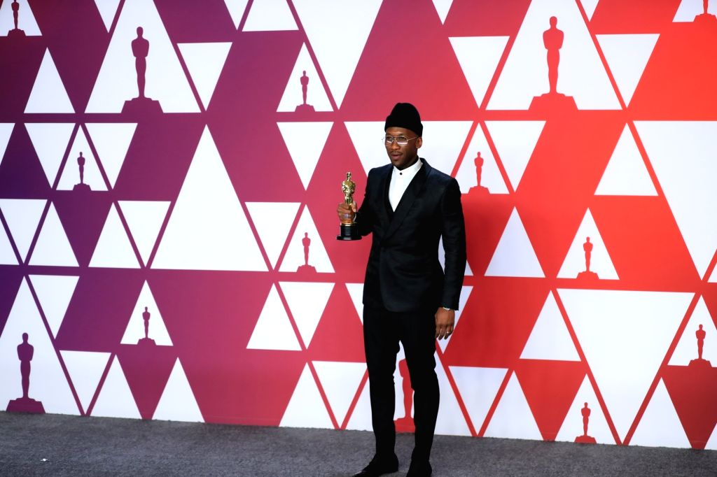 """LOS ANGELES, Feb. 25, 2019 - Mahershala Ali poses for photos after winning the Best Supporting Actor award for """"Green Book"""" in the press room during the 91st Academy Awards ceremony, or the ..."""