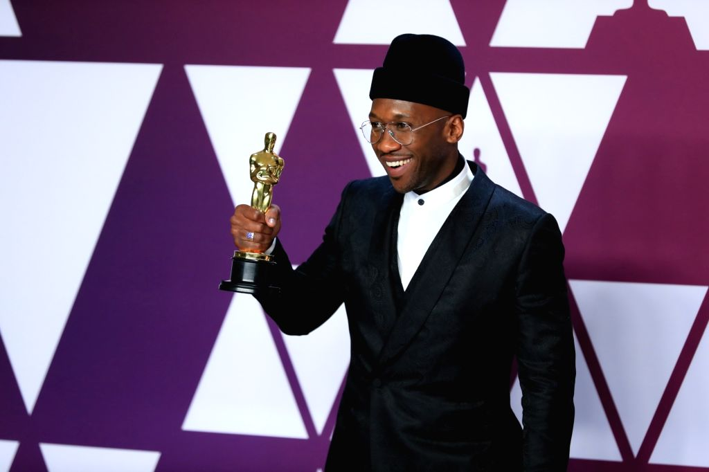 "LOS ANGELES, Feb. 25, 2019 - Mahershala Ali poses for photos after winning the Best Supporting Actor award for ""Green Book"" in the press room during the 91st Academy Awards ceremony, or the ..."