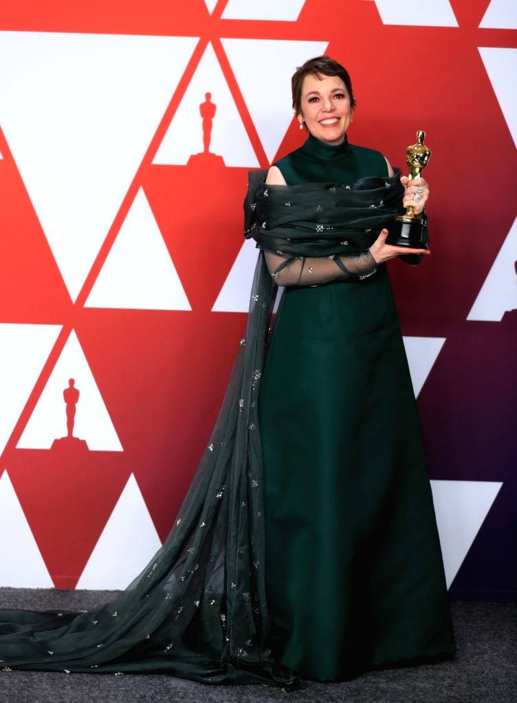 """LOS ANGELES, Feb. 25, 2019 - Olivia Colman poses for photos after winning the Best Actress award for """"The Favourite"""" in the press room during the 91st Academy Awards ceremony, or the ..."""