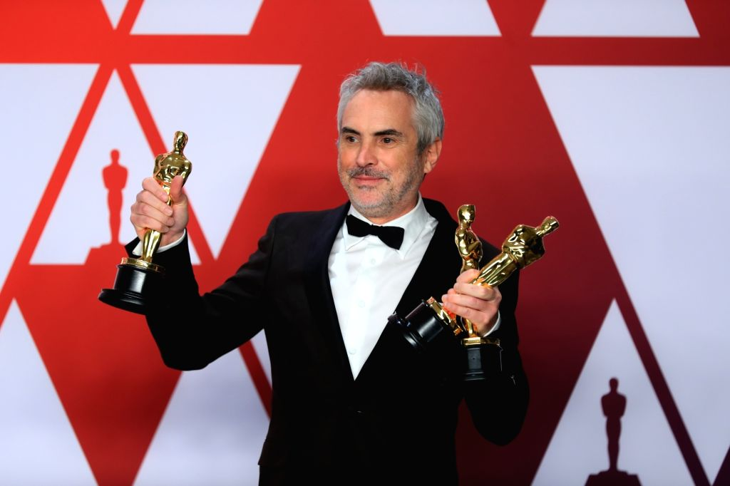 "LOS ANGELES, Feb. 25, 2019 (Xinhua) -- Alfonso Cuaron, winner of the Best Director award for ""Roma"", poses for photos in the press room during the 91st Academy Awards ceremony, or the Oscars, held at the Dolby Theatre in Los Angeles, the United State"