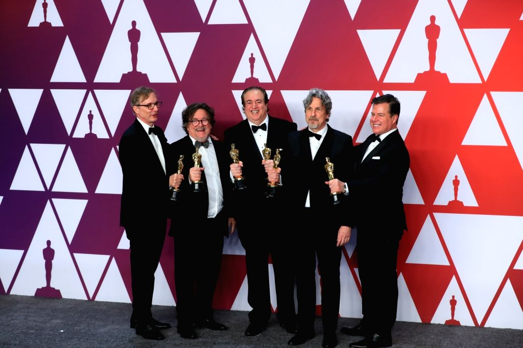 "LOS ANGELES, Feb. 25, 2019 (Xinhua) -- Cast members of the ""Green Book"" pose for photos after winning the Best Picture award in the press room during the 91st Academy Awards ceremony, or the Oscars, held at the Dolby Theatre in Los Angeles, the Unite"