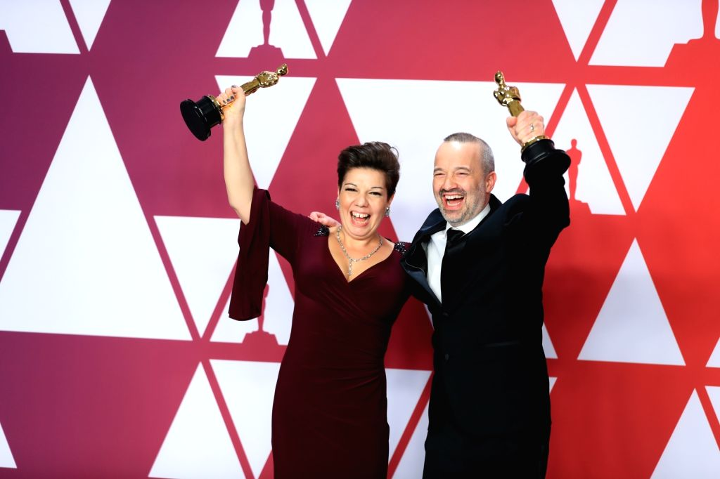 """LOS ANGELES, Feb. 26, 2019 - John Warhurst (R) and Nina Hartstone, winners of the Best Sound Editing award for """"Bohemian Rhapsody,"""" pose in the press room during the 91st Academy Awards at ..."""