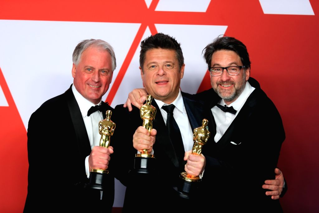"""LOS ANGELES, Feb. 26, 2019 - (L-R) Paul Massey, Tim Cavagin and John Casali, winners of the Best Sound Mixing award for """" Bohemian Rhapsody,"""" pose for photos in the press room during the ..."""
