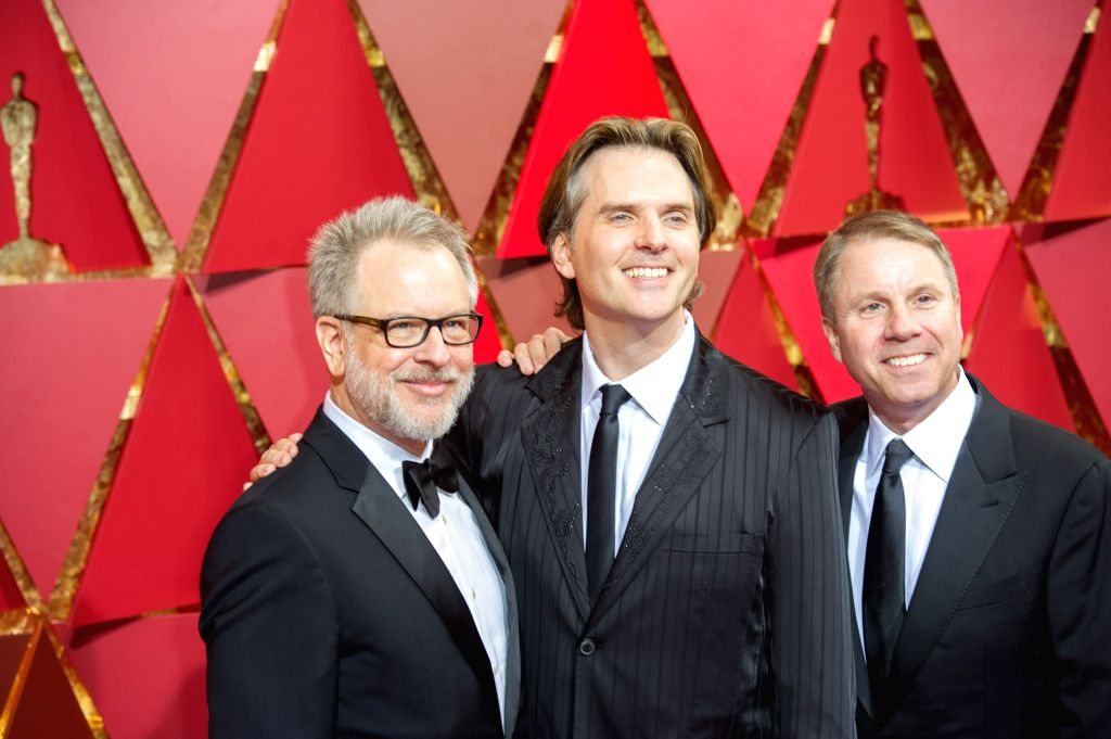 LOS ANGELES, Feb. 27, 2017 - (L-R) Directors Rich Moore, Byron Howard and Jared Bush arrive for the red carpet of the 89th Academy Awards at the Dolby Theater in Los Angeles, the United States, on ...
