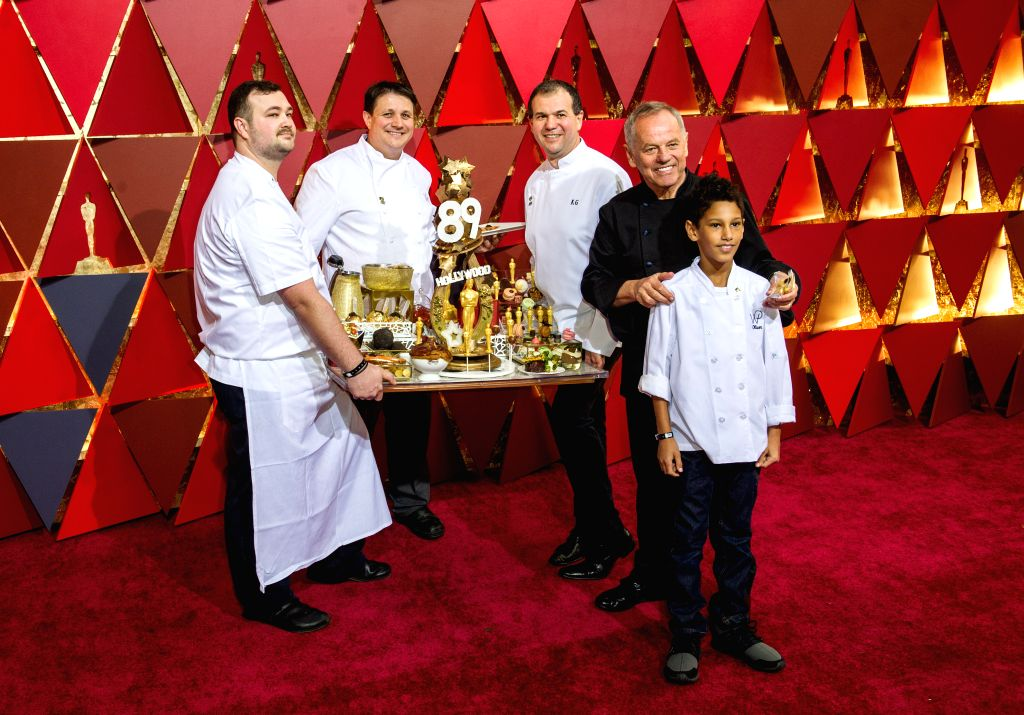 LOS ANGELES, Feb. 27, 2017 - Oscar dinner chef Wolfgang Puck (2nd R) arrives for the red carpet of the 89th Academy Awards at the Dolby Theater in Los Angeles, the United States, on Feb. 26, 2017.