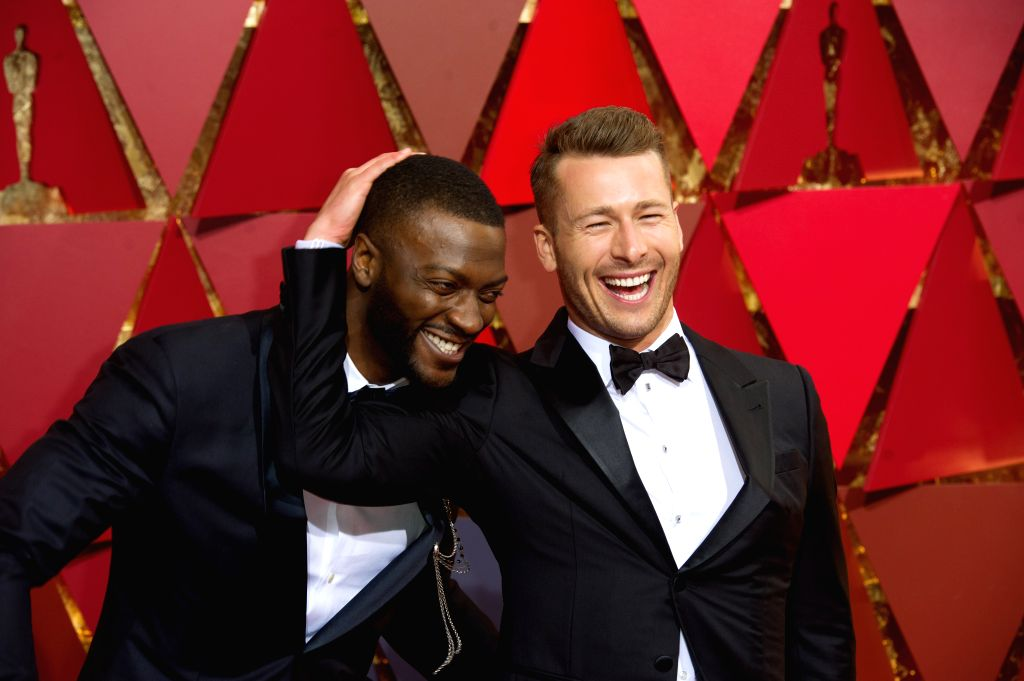 LOS ANGELES, Feb. 27, 2017 - U.S. actors Aldis Hodge (L) and Glen Powell arrive for the red carpet of the 89th Academy Awards at the Dolby Theater in Los Angeles, the United States, on Feb. 26, 2017. - Aldis Hodge