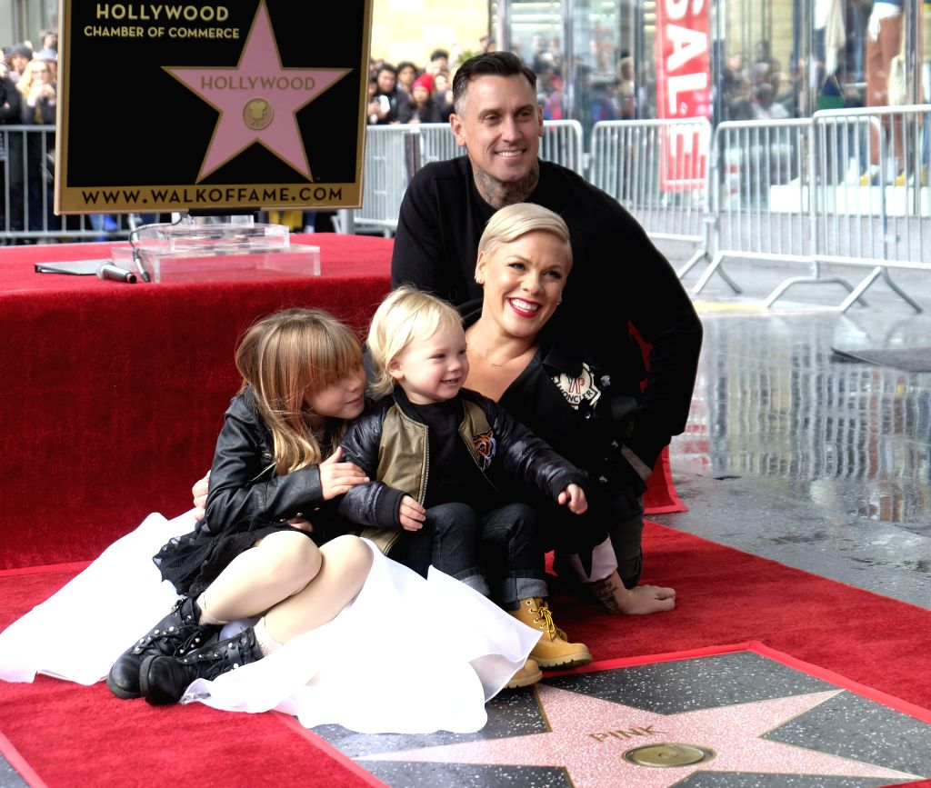 LOS ANGELES, Feb. 6, 2019 - Singer P!nk poses with her family as she receives a star on the Hollywood Walk of Fame in Los Angeles, the United States, Feb. 5, 2019.