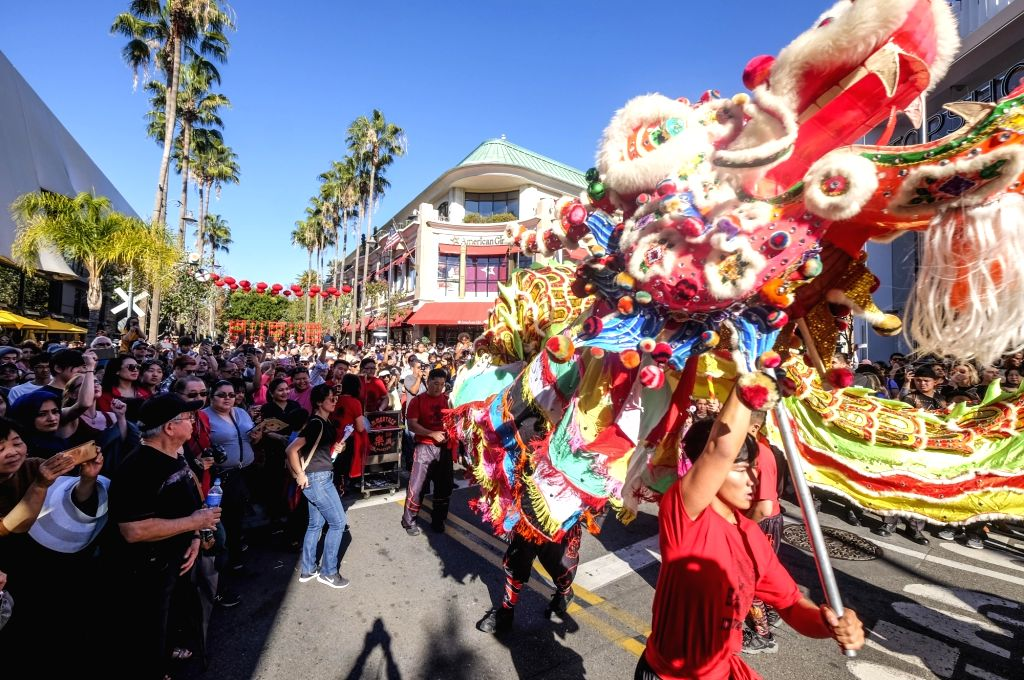 LOS ANGELES, Jan. 29, 2018 - Dragon dancers perform during a celebration for Chinese lunar new year at the Original Farmers Market in Los Angeles, the United States, Jan. 28, 2018.
