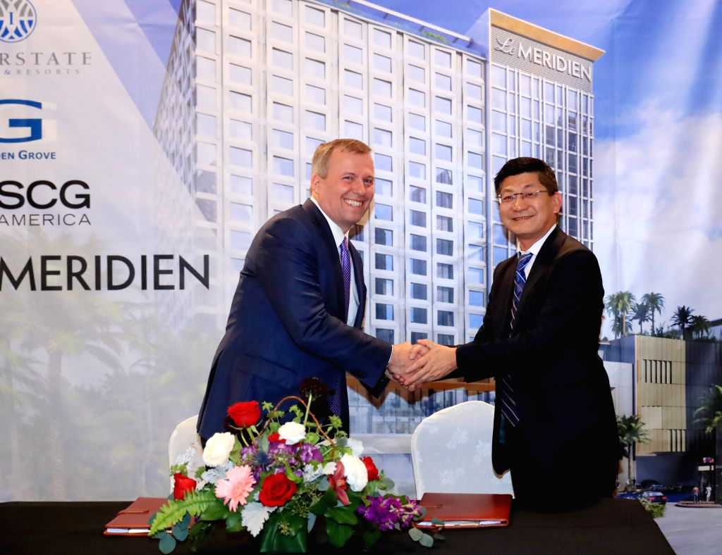 LOS ANGELES, Jan. 31, 2019 - Michael J. Deitemeyer (L), president and CEO of Interstate Hotels & Resorts, shakes hands with Danny Wei, executive vice president of Shanghai Construction Group ...