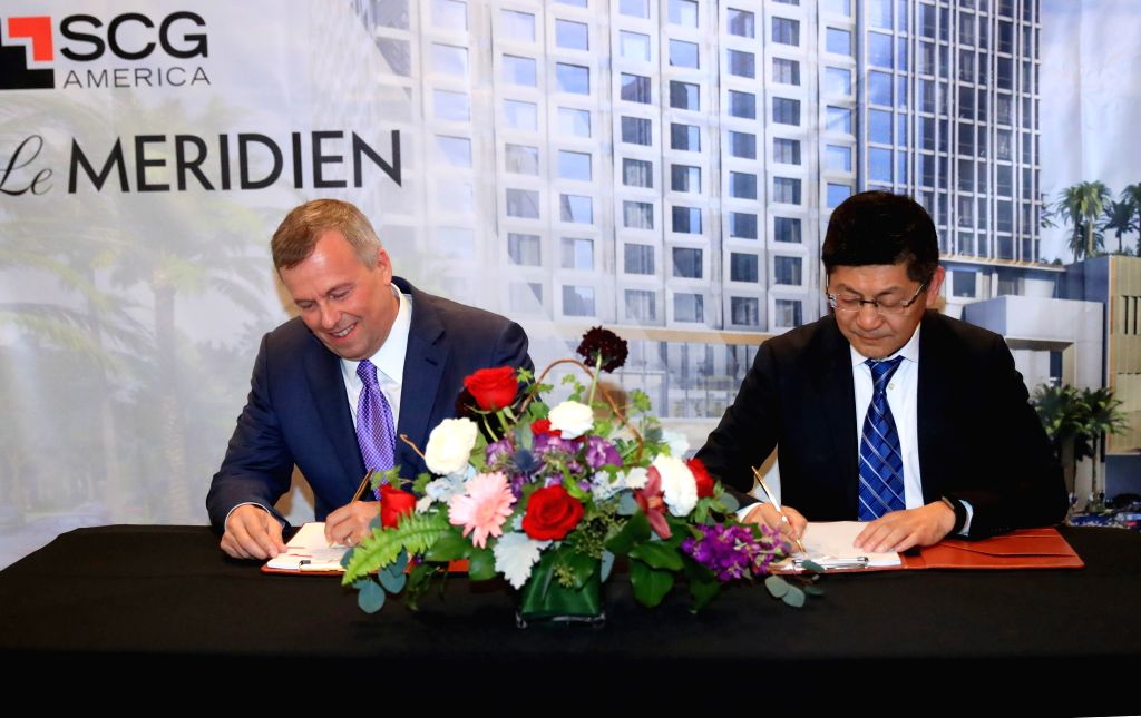 LOS ANGELES, Jan. 31, 2019 - Michael J. Deitemeyer (L), president and CEO of Interstate Hotels & Resorts, signs a management agreement with Danny Wei, executive vice president of Shanghai ...