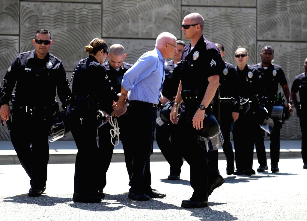 LOS ANGELES, July 2, 2018 (Xinhua) -- A protester is arrested in front of a detention center of U.S. Immigration and Customs Enforcement in downtown Los Angeles, the United States, on July 2, 2018. Seventeen protesters were arrested when they rallied