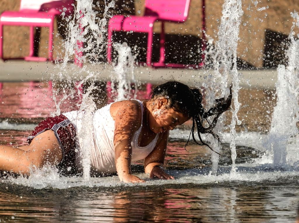 LOS ANGELES, July 25, 2018 - A girl cools off in the fountain at Grand park in downtown Los Angeles, the United States, July 24, 2018. Health officials issued a heat alert for Los Angeles County's ...