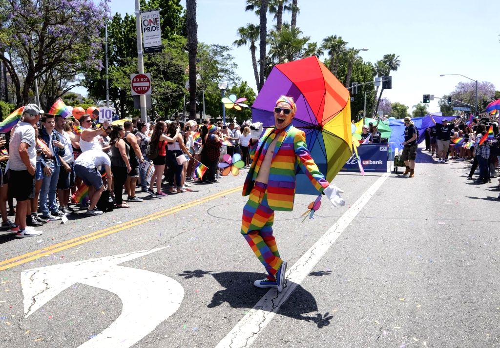 LOS ANGELES, June 11, 2018 - A parade participant with costume marches along Santa Monica Boulevard during the LA Pride Parade in Los Angeles, the United States, June 10, 2018.