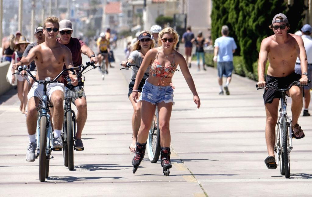 LOS ANGELES, June 16, 2017 - People enjoy themselves near a beach in Los Angeles, the United States, June 15, 2017. Temperatures are expected to climb 6 to 10 degrees centigrade above normal this ...