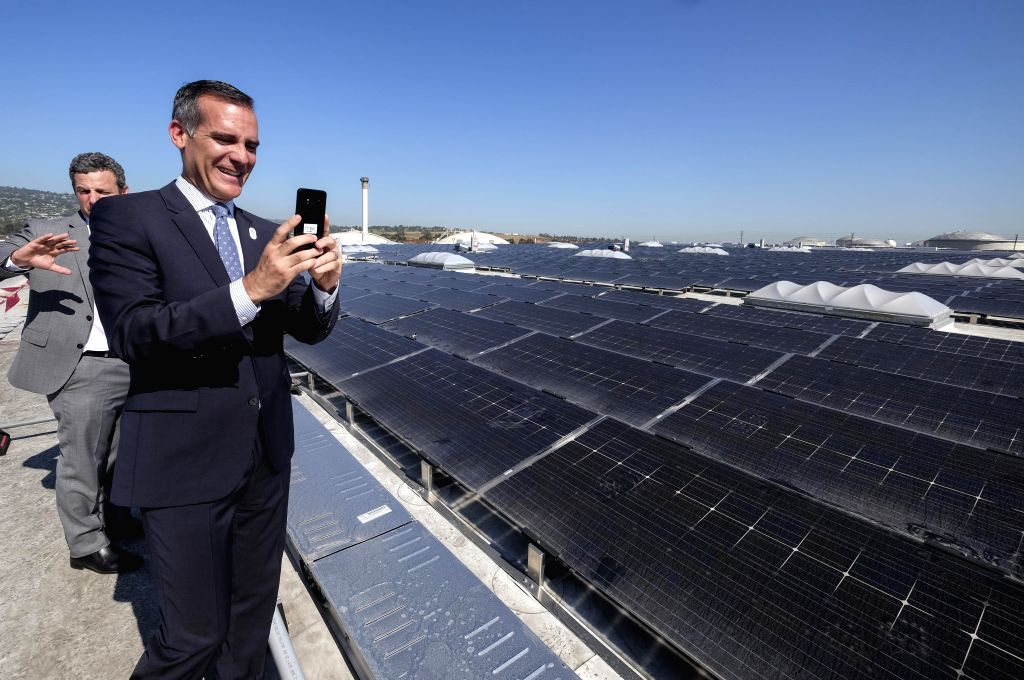 LOS ANGELES, June 27, 2017 - Los Angeles Mayor Eric Garcetti takes pictures of the 16.4 Megawatt (DC) Westmont Solar Energy Project in San Pedro, about 40 km south of Los Angeles, the United States, ...