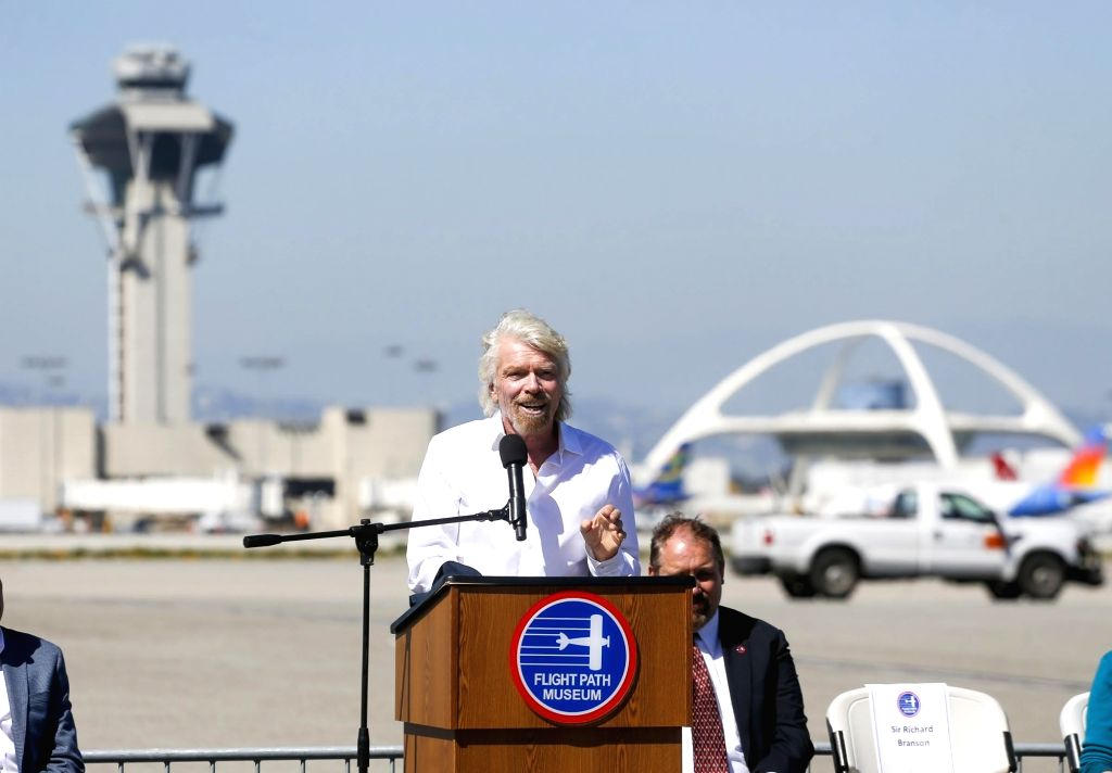 LOS ANGELES, March 29, 2018 - Richard Branson (front), founder of the Virgin Group, speaks as he is inducted into the Flight Path Walk of Fame at Los Angeles International Airport in Los Angeles, the ...
