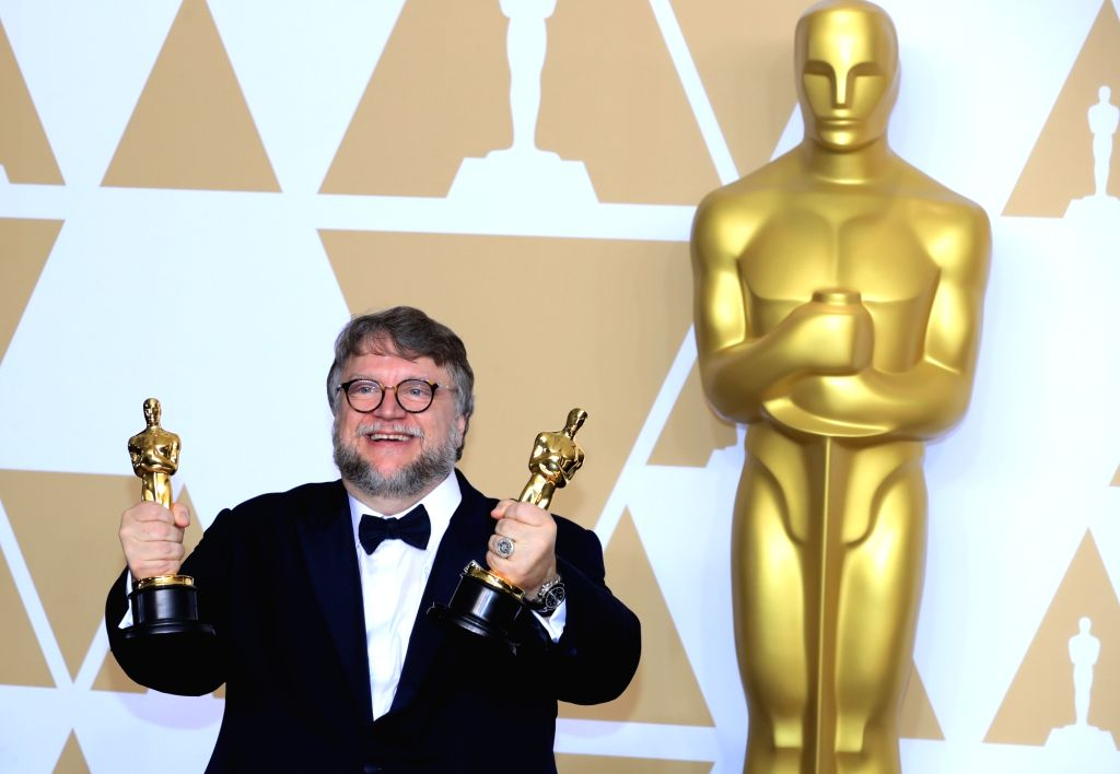 """LOS ANGELES, March 5, 2018 (Xinhua) -- Director Guillermo del Toro poses after winning the Best Director award and the Best Picture award for """"The Shape of Water"""" at press room of the 90th Academy Awards at the Dolby Theater in Los Angeles, the Unite"""