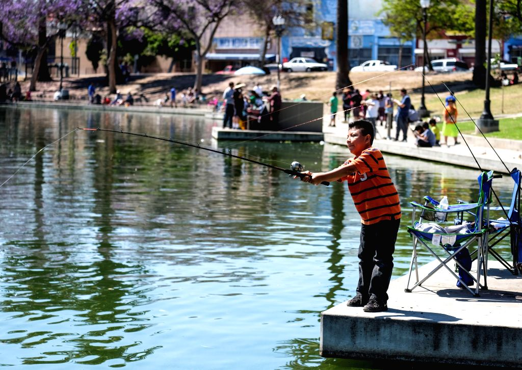 LOS ANGELES, May 14, 2017 - A boy participates in fish training during a youth fishing derby held by the Los Angeles Department of Recreation and Parks in the lake at MacArthur Park near downtown Los ...