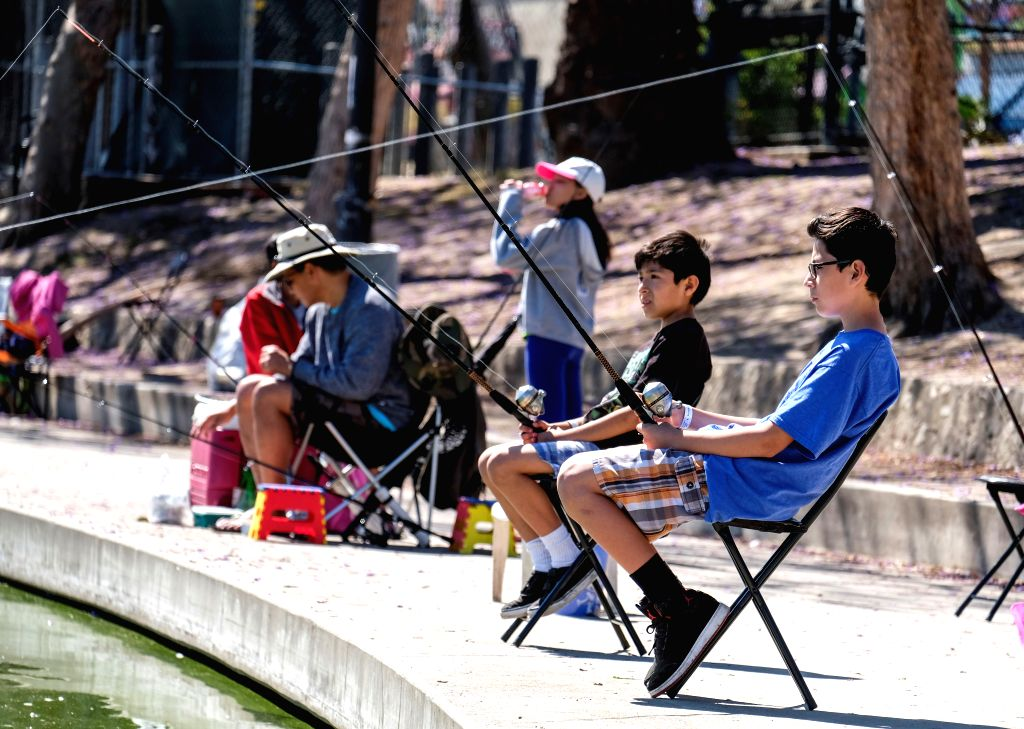 LOS ANGELES, May 14, 2017 - Children participate in fish training during a youth fishing derby held by the Los Angeles Department of Recreation and Parks in the lake at MacArthur Park near downtown ...