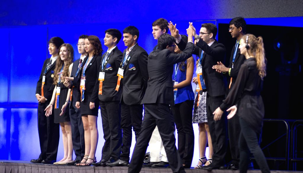 Award winners celebrate on the stage during the award ceremony of Intel International Science and Engineering Fair (Intel ISEF) in Los Angeles, United States, ...