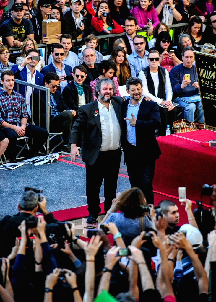 Los Angeles: New Zealand director Peter Jackson (L) and British actor Andy Serkis (R) attend the ceremony honoring Jackson with a star on the Hollywood Walk of Fame, in Hollywood, California, the ... - Andy Serkis