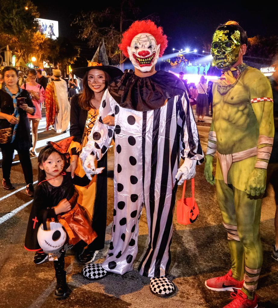 LOS ANGELES, Nov. 1, 2018 - Halloween revelers in costume attend the West Hollywood Halloween costume carnival in Los Angeles, the United States, on Oct. 31, 2018.