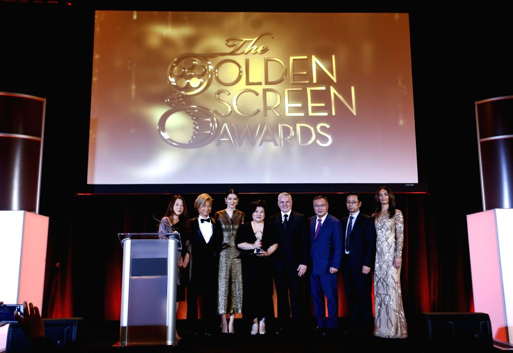 """LOS ANGELES, Nov. 10, 2019 - Cast members of """"The Composer"""" and guests pose for photos at the awards ceremony of the 2019 Golden Screen Awards in Los Angeles, the United States, on Nov. 9, ..."""