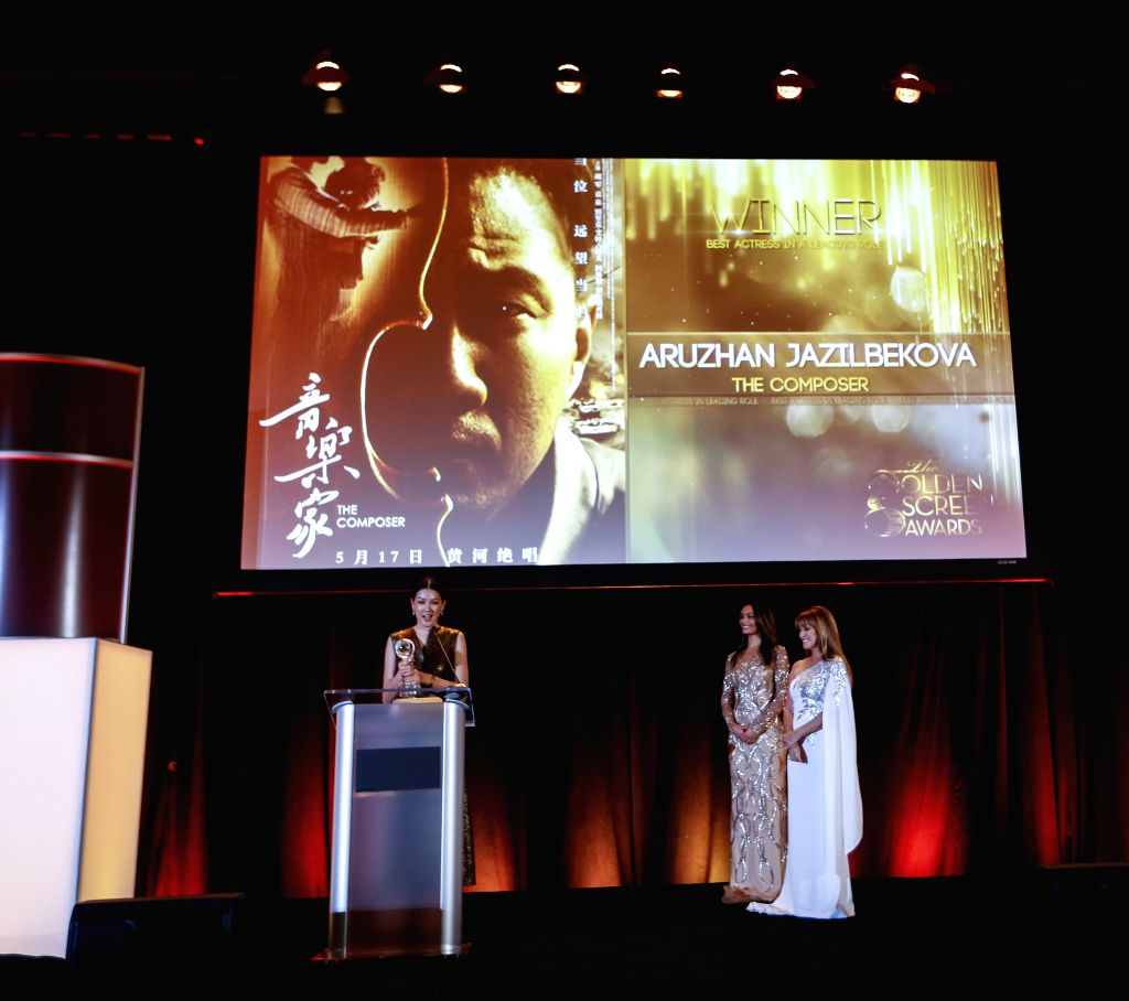 LOS ANGELES, Nov. 10, 2019 - Kazakh actress Aruzhan Jazilbekova (L) speaks after she was awarded the Best ing Actress at the awards ceremony of the 2019 Golden Screen Awards in Los Angeles, the ... - Aruzhan Jazilbekova