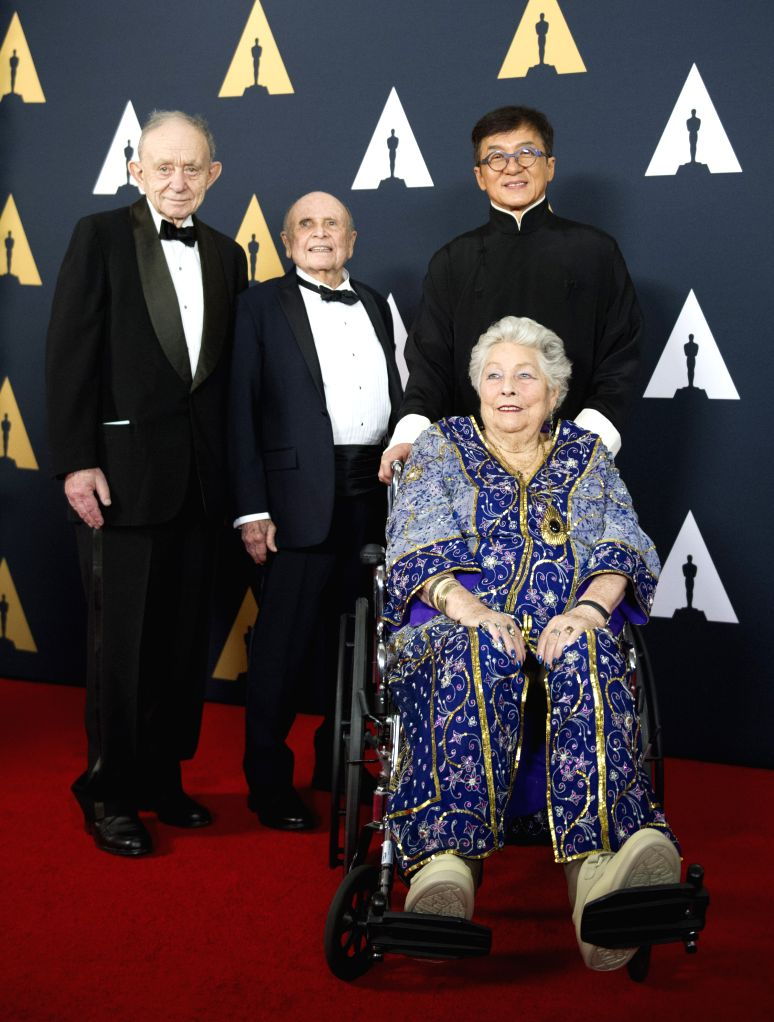 LOS ANGELES, Nov. 13, 2016 - Jackie Chan takes photos with other three recipients of Honorary Award as he attends the eighth annual Governors Awards ceremony in Hollywood, California, the United ... - Jackie Chan