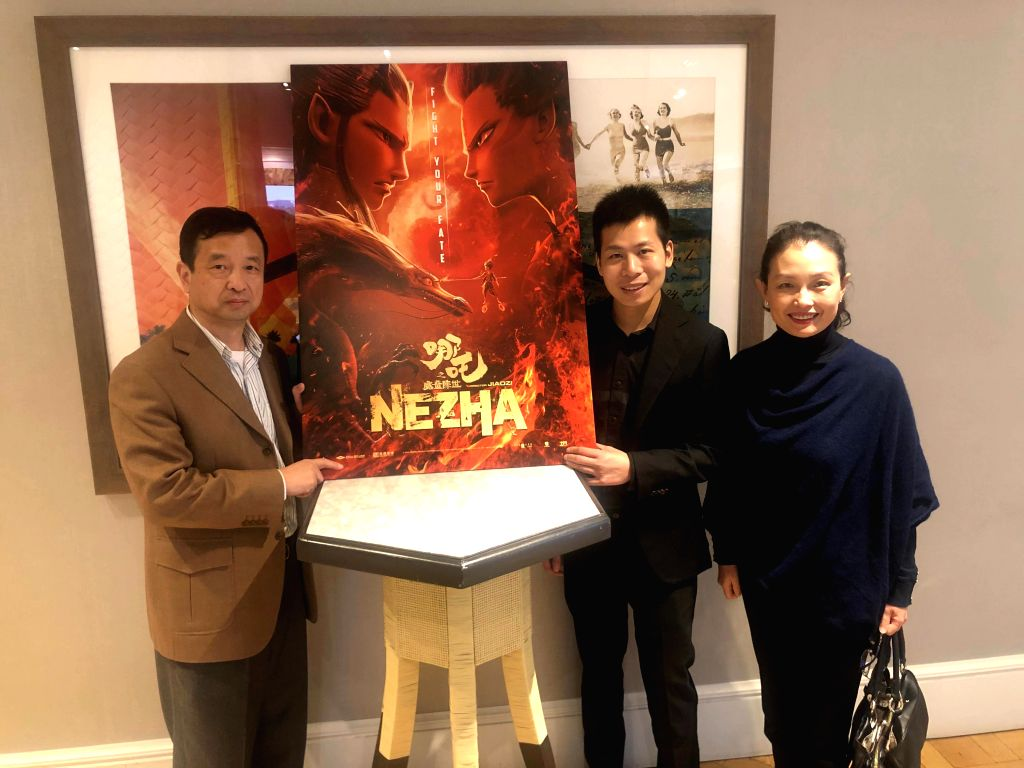 """LOS ANGELES, Nov. 21, 2019 - Yi Qiao (2nd R), CEO of animation shingle Coloroom Pictures, poses with a poster of """"Ne Zha"""" at the film's official Academy screening in West Hollywood, the ..."""