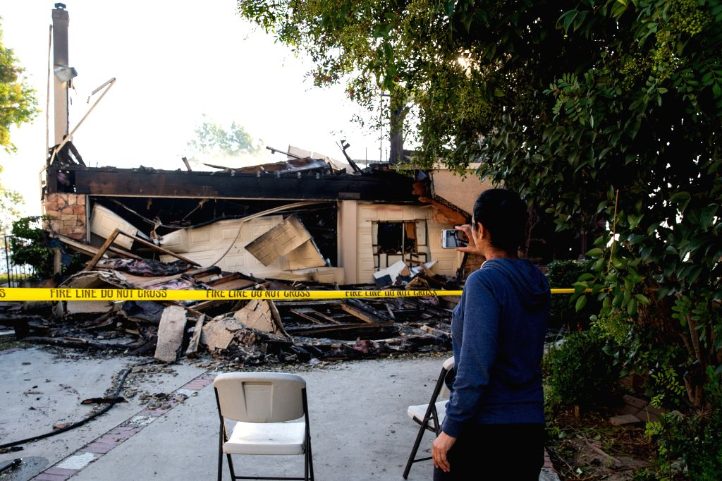 LOS ANGELES, Oct. 13, 2019 - Burnt houses are seen following a fire at Sylma, northwest of Los Angeles downtown, the United States, Oct. 12, 2019. The Saddleridge Fire in Los Angeles County, the ...