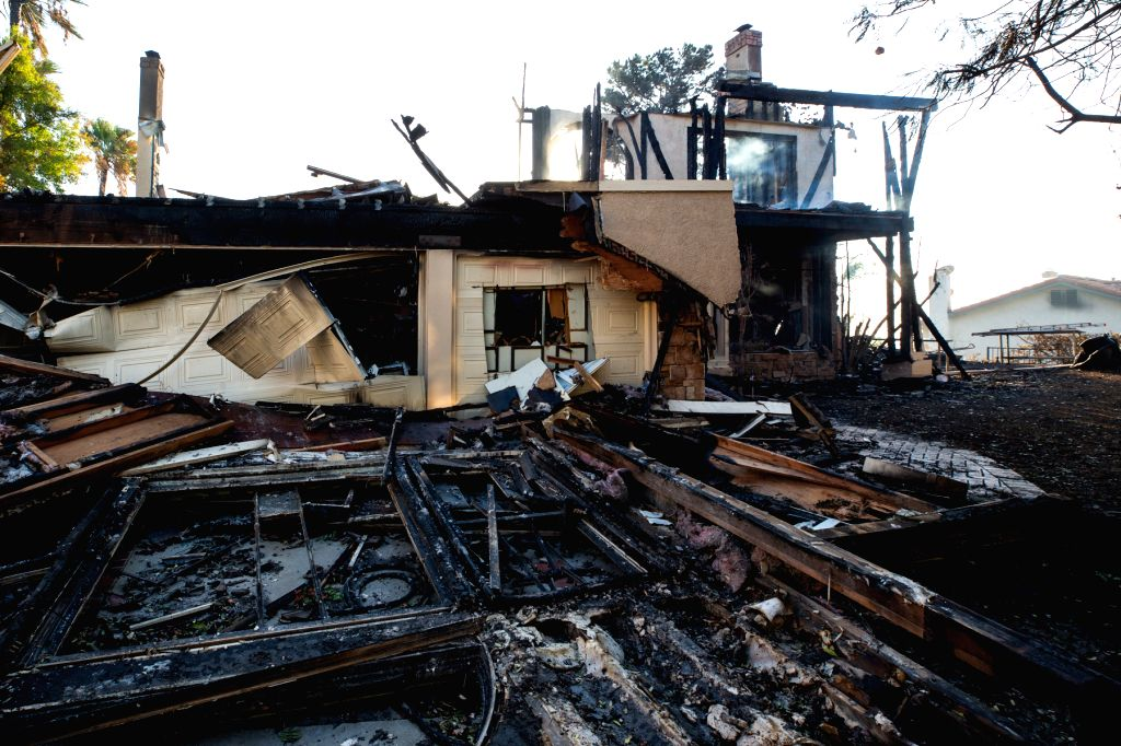 LOS ANGELES, Oct. 13, 2019 (Xinhua) -- Burnt houses are seen following a fire at Sylma, northwest of Los Angeles downtown, the United States, Oct. 12, 2019. The Saddleridge Fire in Los Angeles County, the largest in Southern California, has scorched