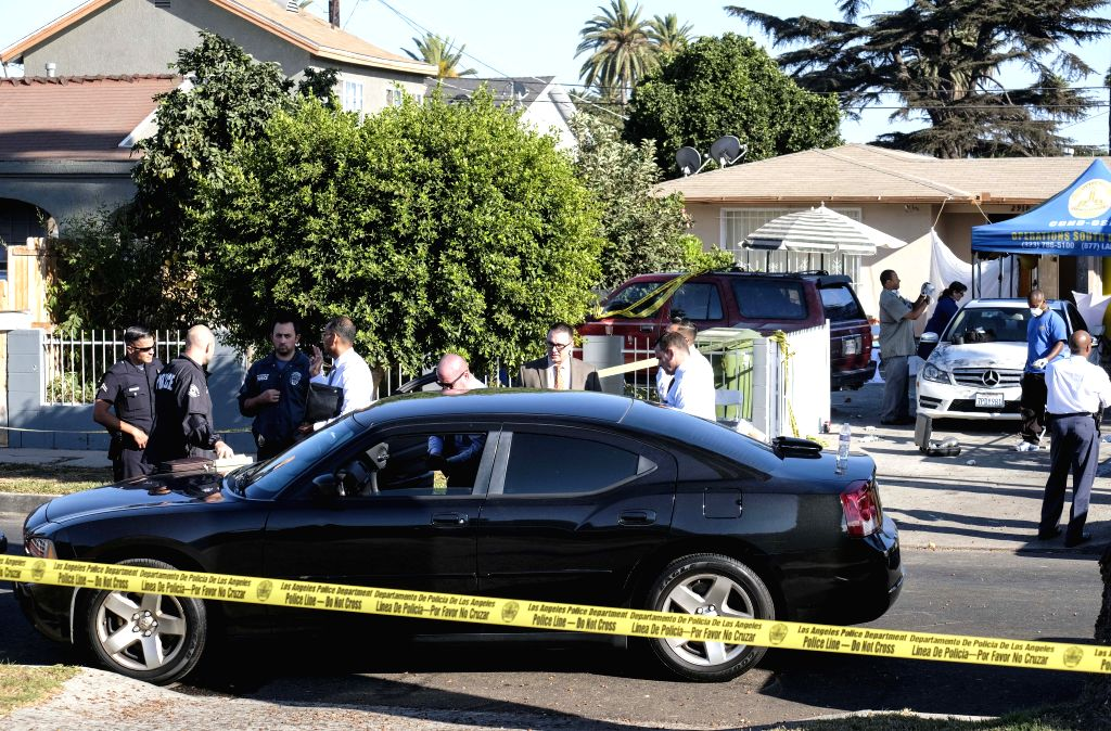 LOS ANGELES, Oct. 16, 2016 - Los Angeles police and investigators work at the scene of a fatal shooting in Los Angeles, the United States, Oct. 15, 2016. Three people were killed and 12 others ...