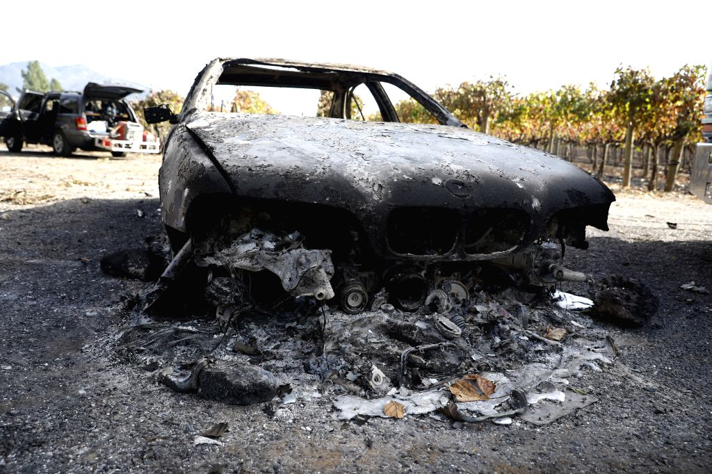 LOS ANGELES, Oct. 25, 2019 - Photo taken on Oct. 24, 2019 shows a burnt car in Sonoma County, the U.S. state of California. Fast-growing wild fires throughout California on Thursday burned down ...
