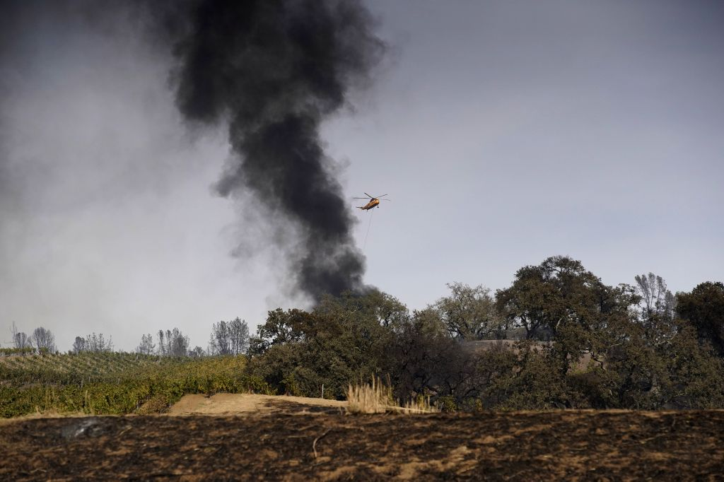 LOS ANGELES, Oct. 25, 2019 - Smoke rises from a fire site in Sonoma County, the U.S. state of California, Oct. 24, 2019. Fast-growing wild fires throughout California on Thursday burned down dozens ...