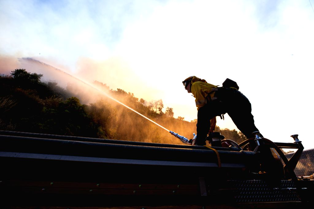 LOS ANGELES, Oct. 29, 2019 - A firefighter works near Getty Center in Los Angeles, the United States, Oct. 28, 2019. Thousands of residents were forced to evacuate their homes after a fast-moving ...