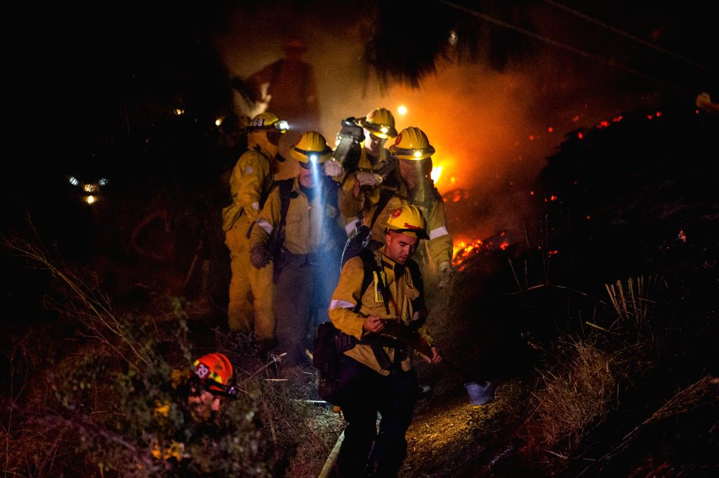 LOS ANGELES, Oct. 29, 2019 - Firefighters work near Getty Center in Los Angeles, the United States, Oct. 28, 2019. Thousands of residents were forced to evacuate their homes after a fast-moving ...
