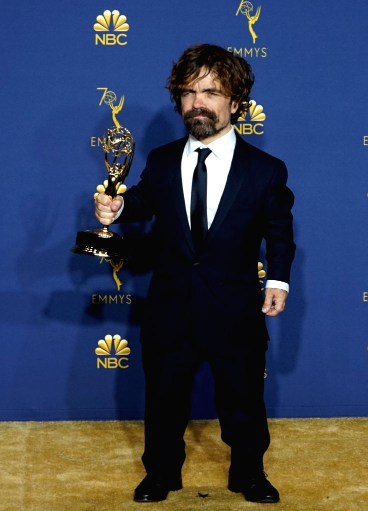 """LOS ANGELES, Sept. 18, 2018 - Actor Peter Dinklage poses with the award for most outstanding supporting actor in a drama series for """"Game of Thrones"""" during the 70th Primetime Emmy Awards ... - Peter Dinklage"""