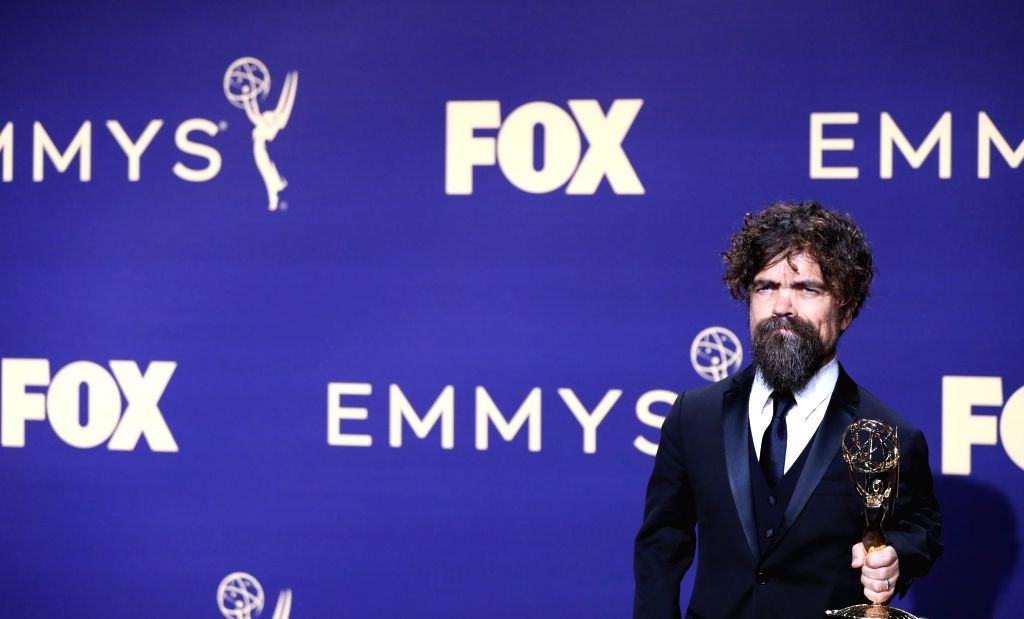 """LOS ANGELES, Sept. 23, 2019 - Actor Peter Dinklage poses with the award for outstanding supporting actor in a drama series for """"Game of Thrones"""" during the 71st Primetime Emmy Awards in Los ... - Peter Dinklage"""