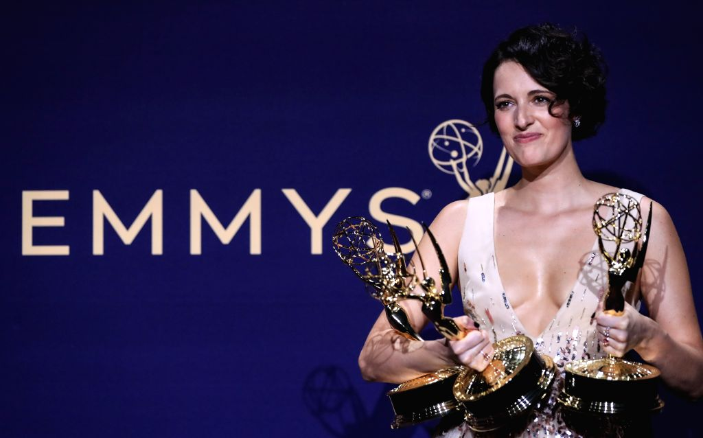 LOS ANGELES, Sept. 23, 2019 - Actress Phoebe Waller-Bridge poses with the awards for outstanding lead actress in a comedy series, outstanding comedy series and outstanding writing for a comedy series ... - Phoebe Waller-Bridge