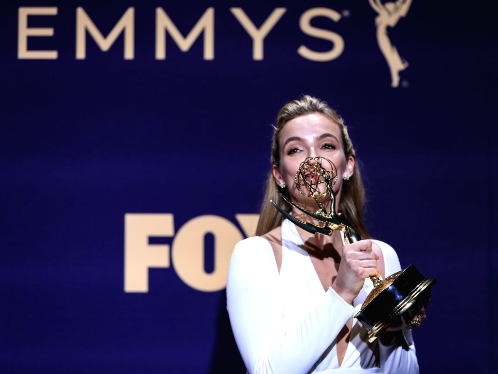 "LOS ANGELES, Sept. 23, 2019 (Xinhua) -- Actress Jodie Comer poses with the award for outstanding lead actress in a drama series for ""Killing Eve"" during the 71st Primetime Emmy Awards in Los Angeles, the United States, Sept. 22, 2019. (Xinhua/Li Ying - Jodie Comer"