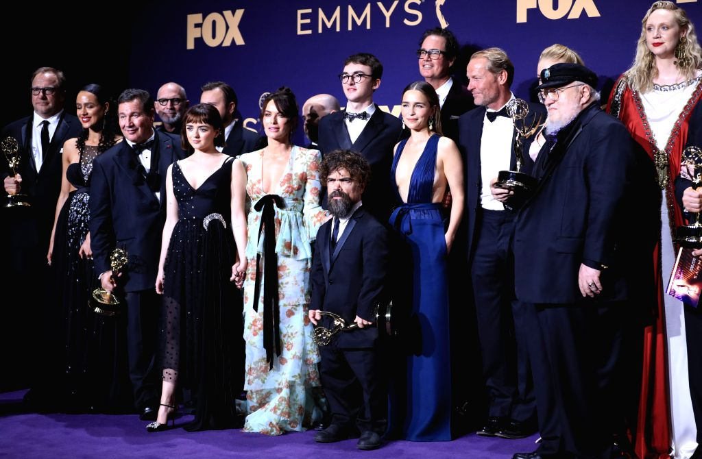 """LOS ANGELES, Sept. 23, 2019 (Xinhua) -- Cast members of """"Game of Thrones"""" pose with the award for outstanding drama series during the 71st Primetime Emmy Awards in Los Angeles, the United States, Sept. 22, 2019. (Xinhua/Li Ying/IANS)"""