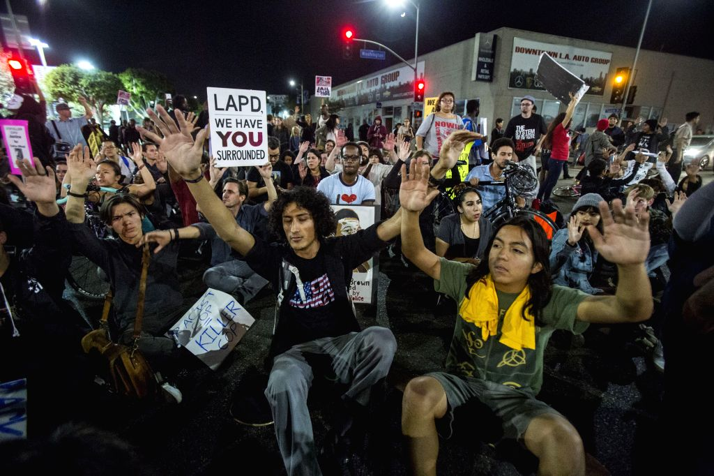 Los Angeles (United States): Demonstrators sit on an intersection during a protest in Los Angeles, United States, on November 25, 2014. Thousands of people in Washington, New York, Boston and a dozen