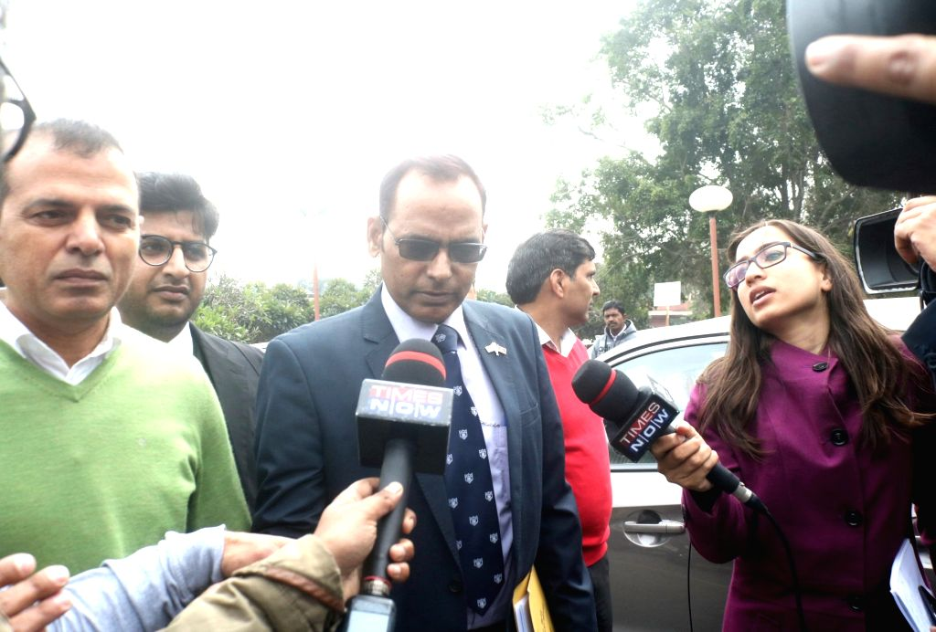 Lt Col Karamveer Singh, father of Major Aditya Kumar, named in an FIR by Jammu and Kashmir Police in civilian killings during a firing incident, talks to the press at Supreme court after a ... - Karamveer Singh and Aditya Kumar