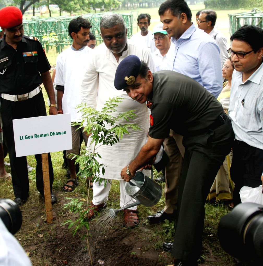 Lt Gen Raman Dhawan, GOC Bengal Area at the launch of `O2000` campaign where he planted a sapling and interacted with school children at Maidan in Kolkata on July 24, 2014.