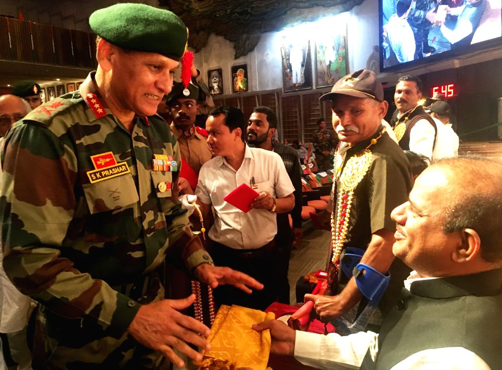 Lt. Gen. S. K. Prashar, GOC-in-C, Maharashtra, Gujarat & Goa honours a disabled Indian Army soldier to mark the 71st Republic Day celebrations in Mumbai on Jan 26, 2020. 15 disabled ...
