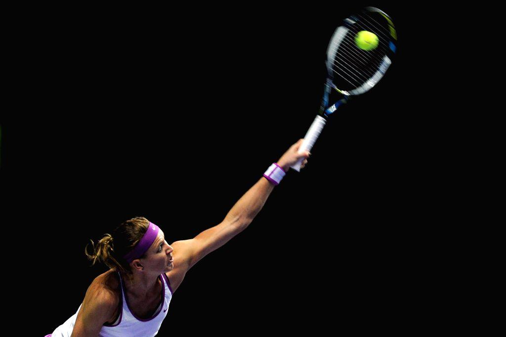 Lucie Safarova of the Czech Republic serves during the WTA Finals round robin match against Garbine Muguruza of Spain at Singapore Indoor Stadium in Singapore,  ...