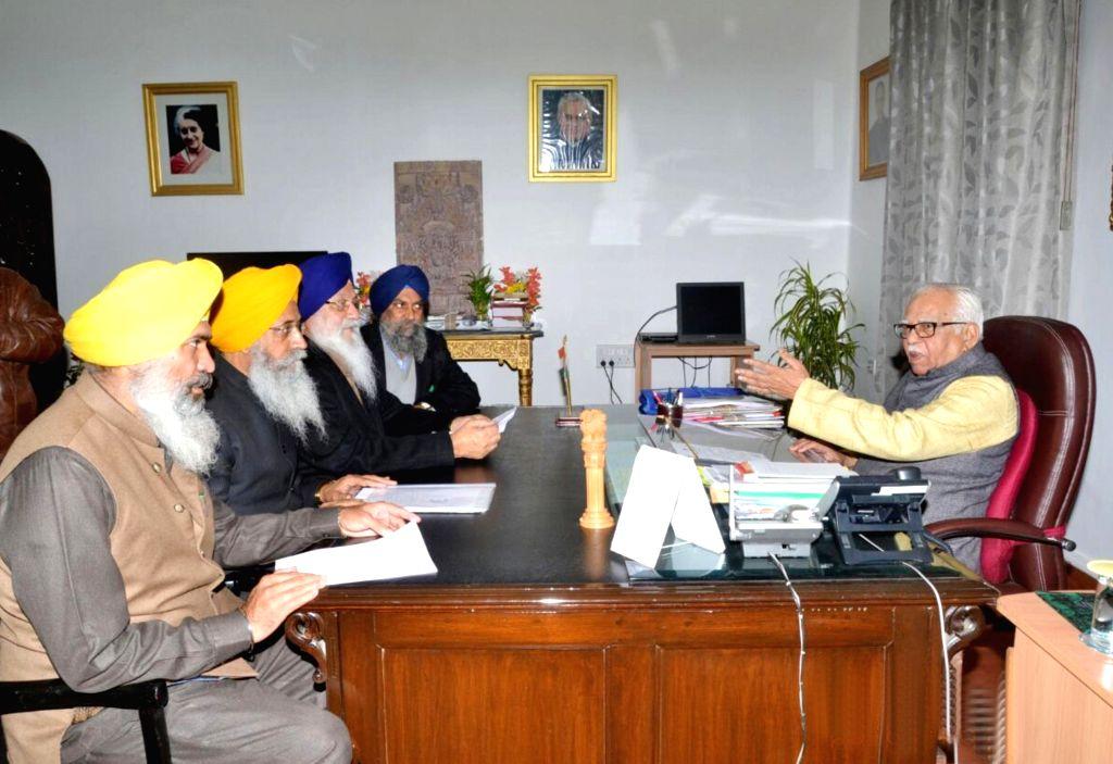 A delegation led by SGPC president Avtar Singh Makkar calls on Uttar Pradesh Governor Ram Naik in Lucknow, on Jan 10, 2015. - Avtar Singh Makkar